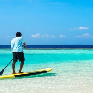 Lily Beach Resort and Spa at Huvahendhoo - Luxury Maldives Honeymoon Packages - Beach Villa paddle boarding