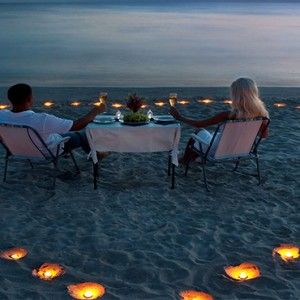 Lily Beach Resort and Spa at Huvahendhoo - Luxury Maldives Honeymoon Packages - Candlelit dining