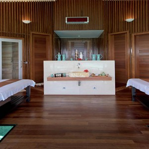 Lily Beach Resort and Spa at Huvahendhoo - Luxury Maldives Honeymoon Packages - Couple Spa room with glass floor