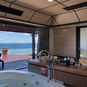 Lily Beach Resort and Spa at Huvahendhoo - Luxury Maldives Honeymoon Packages - Deluxe Water Villa bathroom view