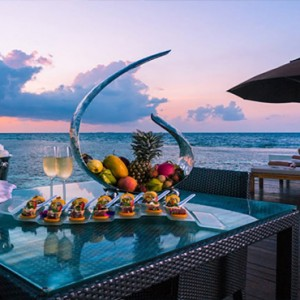Lily Beach Resort and Spa at Huvahendhoo - Luxury Maldives Honeymoon Packages - Deluxe Water Villa dining on deck