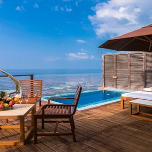 Lily Beach Resort and Spa at Huvahendhoo - Luxury Maldives Honeymoon Packages - Deluxe Water Villa pool