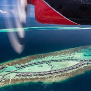 Lily Beach Resort and Spa at Huvahendhoo - Luxury Maldives Honeymoon Packages - Deluxe Water Villa seaplane transfer view