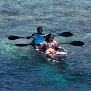 Lily Beach Resort and Spa at Huvahendhoo - Luxury Maldives Honeymoon Packages - Glass Canoe
