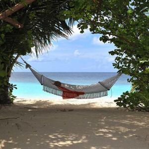 Lily Beach Resort and Spa at Huvahendhoo - Luxury Maldives Honeymoon Packages - Lagoon Villa hammock