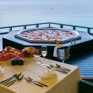 Lily Beach Resort and Spa at Huvahendhoo - Luxury Maldives Honeymoon Packages - Private spa dinner