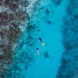 Lily Beach Resort and Spa at Huvahendhoo - Luxury Maldives Honeymoon Packages - Snorkelling in reef