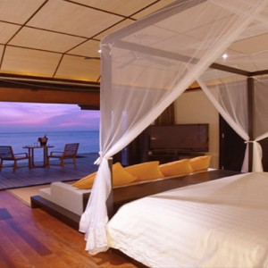 Lily Beach Resort and Spa at Huvahendhoo - Luxury Maldives Honeymoon Packages - Sunset Water Suite bedroom