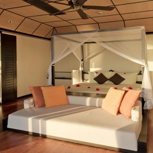 Lily Beach Resort and Spa at Huvahendhoo - Luxury Maldives Honeymoon Packages - Sunset Water Suite bedroom1