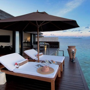 Lily Beach Resort and Spa at Huvahendhoo - Luxury Maldives Honeymoon Packages - Sunset Water Suite deck