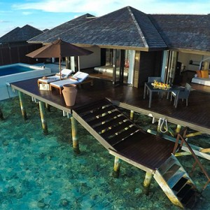 Lily Beach Resort and Spa at Huvahendhoo - Luxury Maldives Honeymoon Packages - Sunset Water Suite exterior