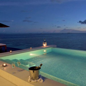 Lily Beach Resort and Spa at Huvahendhoo - Luxury Maldives Honeymoon Packages - Sunset Water Suite pool at night