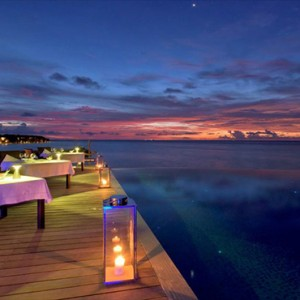 Lily Beach Resort and Spa at Huvahendhoo - Luxury Maldives Honeymoon Packages - aqva at night