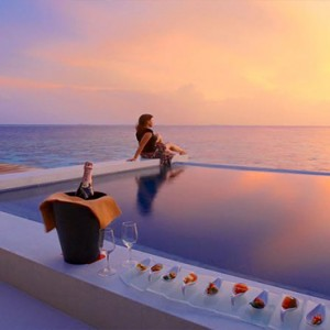 Lily Beach Resort and Spa at Huvahendhoo - Luxury Maldives Honeymoon Packages - pool view at sunset