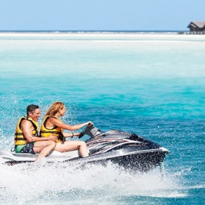 Lux South Ari Atoll - Luxury Maldives Honeymoon Packages - Jetskiing