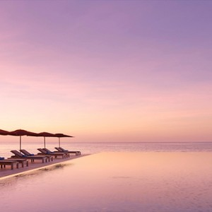 Lux South Ari Atoll - Luxury Maldives Honeymoon Packages - Main pool at sunset