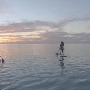 Lux South Ari Atoll - Luxury Maldives Honeymoon Packages - Paddle boarding