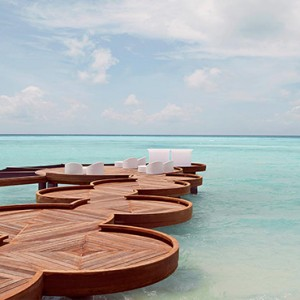 Lux South Ari Atoll - Luxury Maldives Honeymoon Packages - Seating area over lagoon