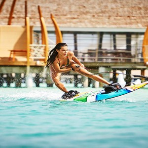 Lux South Ari Atoll - Luxury Maldives Honeymoon Packages - Surfboarding