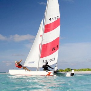 Lux South Ari Atoll - Luxury Maldives Honeymoon Packages - Topcat sailing