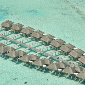 Maafushivaru - Luxury Maldives Honeymoon Packages - Aerial view of overwater villas