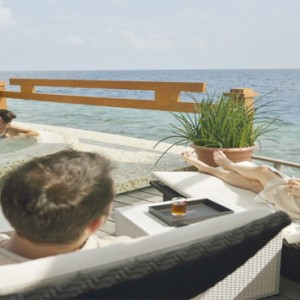 Maafushivaru - Luxury Maldives Honeymoon Packages - Couples relaxing by jacuzzi