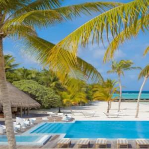 Maafushivaru - Luxury Maldives Honeymoon Packages - Pool and beach view