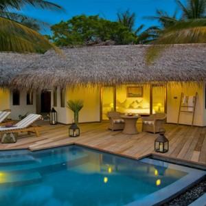 Maafushivaru - Luxury Maldives Honeymoon Packages - Pool villas exterior at night
