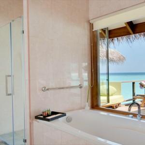 Maafushivaru - Luxury Maldives Honeymoon Packages - Water Villas bathroom with a view