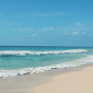 Mexico Honeymoon Packages Secrets The Vine Cancun Couple Walking On Beach