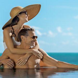 Mexico Honeymoon Packages Zoetry Paraiso De La Bonita Riviera Maya Couple In Pool
