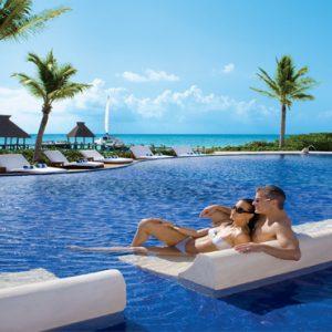 Mexico Honeymoon Packages Zoetry Paraiso De La Bonita Riviera Maya Couple Relaxing In Pool