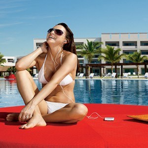 Mexico Honeymoons Packages Secrets Silversands Riviera Cancun – Woman At Pool