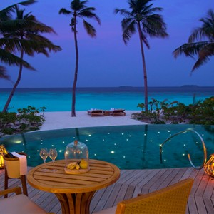 Milaidhoo Island Maldives - Luxury Maldives Honeymoon Packages - Beach Pool Villas exterior view at night