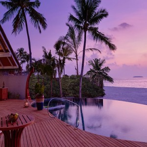 Milaidhoo Island Maldives - Luxury Maldives Honeymoon Packages - Beach Residence pool deck at night