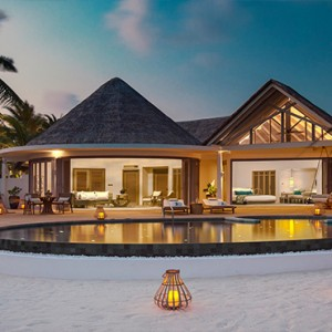 Milaidhoo Island Maldives - Luxury Maldives Honeymoon Packages - Beach Residence pool deck at sunset
