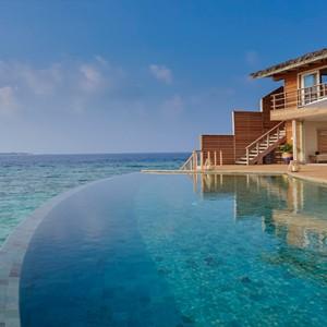 Milaidhoo Island Maldives - Luxury Maldives Honeymoon Packages - Ocean Residence pool deck