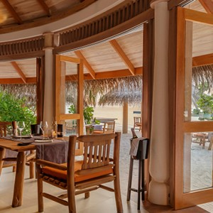 Milaidhoo Island Maldives - Luxury Maldives Honeymoon Packages - The Shoreline Grill interior dining at night