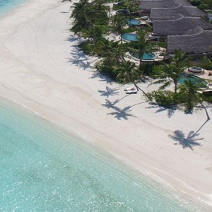 Milaidhoo Island Maldives - Luxury Maldives Honeymoon Packages - aerial view of beach and ocean