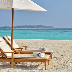 Milaidhoo Island Maldives - Luxury Maldives Honeymoon Packages - beach loungers