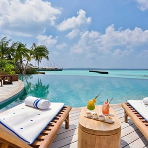 Milaidhoo Island Maldives - Luxury Maldives Honeymoon Packages - pool loungers