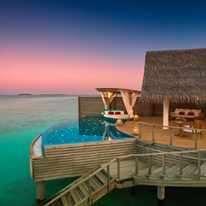 Milaidhoo Island Maldives - Luxury Maldives Honeymoon Packages - water pool villa overview at sunset