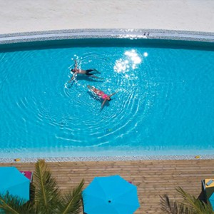 OBLU by Atmosphere at Helengali - Luxury Maldives Honeymoon Packages - Aerial view of adult only pool1