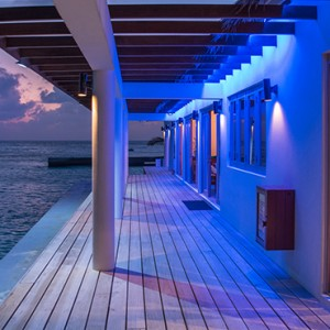 OBLU by Atmosphere at Helengali - Luxury Maldives Honeymoon Packages - Cooee Bistro exterior view at night