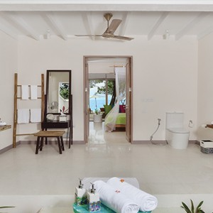 OBLU by Atmosphere at Helengali - Luxury Maldives Honeymoon Packages - Deluxe Beach Villa bathroom1