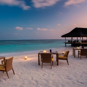 OBLU by Atmosphere at Helengali - Luxury Maldives Honeymoon Packages - Just Grill restaurant exterior dining on beach
