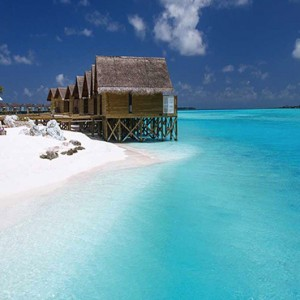 Ozen by Atmosphere at Maadhoo Island - Luxury Maldives Honeymoon Packages - Elena Spa treatment beach