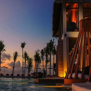 Ozen by Atmosphere at Maadhoo Island - Luxury Maldives Honeymoon Packages - Joie de vivre exterior at night