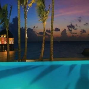 Ozen by Atmosphere at Maadhoo Island - Luxury Maldives Honeymoon Packages - Joie de vivre pool at night