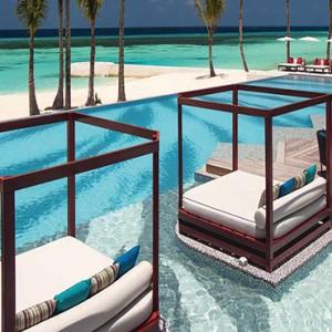 Ozen by Atmosphere at Maadhoo Island - Luxury Maldives Honeymoon Packages - Joie de vivre pool cabana1